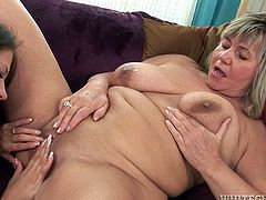 Teen Lara Sweet and old Venuse have wild sex. These lesbians lick and also toy each others pussies lying on a sofa.