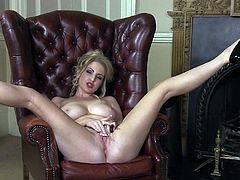 Nasty blonde stretches her shaved twat in a sexy and naughty solo show