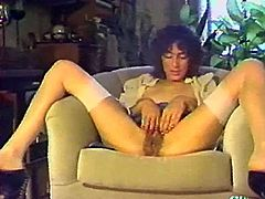 Have a blast looking at this solo model clip. A woman sitting on her couch touches herself with her legs wide open in front of the camera.