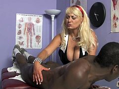 Check this blonde cougar, with gigantic gazongas wearing sexy lingerie, while she gets fucked hard after she gives this dude a massage.
