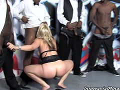 Touch yourself watching this blonde babe, with a nice ass wearing a sexy dress, while she has interracial sex with a lot of black guys.