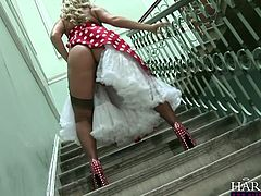 She stands on staircase and seduces this two horny guys with her nice juicy ass. Then she comes in lounge and rubs her twat in Harmony Vision sex clip!