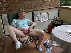 Flabby time worn granny pulls her panties aside and rubs her loose fuckin' twat on the green chair. Watch this nasty masturbation in Old Nanny xxx video!