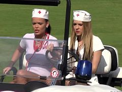 Watch these horny babes dressed as nurses having a threesome with a guy on top of a golf cart outdoors as you hear them moan.