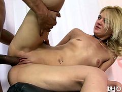 This gorgeous blondie in high heels is a natural born cock sucker. She sucks her lover's big cock like a pro. Then she rides him passionately in cowgirl position making her fine ass shake like jello.