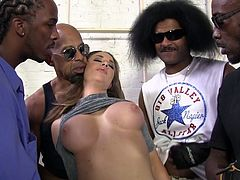 The whole crew of black guys gets a turn at her fuck holes when they gangbang their hot, white boss on the job site then cum on her face.