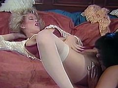 Watch this horny and slutty babe Amber Lynnn enjoying her girlfriend's toungue inher pussy in The Classic Porn sex clips.