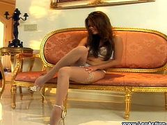 Check this Asian brunette, with big jugs wearing nylon stockings and white lingerie, while she uses her soft hands to touch herself over a couch.