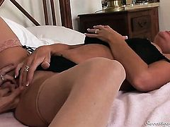 Nina Hartley gets turned on and then tongue fucked by her lesbian friend Rachel Steele