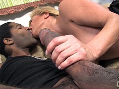 Get a boner watching this blonde MILF, with giant tits and a nice ass, while she has interracial sex and moans like a slutty pornstar!