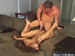 Hot brown-haired girl sits on the floor and gives a blowjob with great pleasure. Later on a guy puts on a condom and starts to fuck the girl as hard as he can.