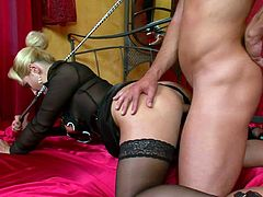 Sensual blonde with sexy glasses enjoys dominating her guy and making him obey