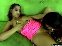 Bootyful ebony babe lies on couch while her horny black girlfriend smears her huge ass and her tits with oil. Black babes rubs down each other's big boobs and lick their wet hungry coochies.