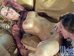 Devinn Lane and Jessica Drake strip each other down, licking every inch as they do. Jeans come off and the fingering starts in this hot lesbian scene!