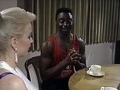 Shy African dude invited his big boobs pal for a cup of tea. But that huge Mamillas tootsie was so much seductive, that he couldn't sit any more. He threw her on floor, made her legs spread and began eating her damnly hot kitty in passion. Watch it in The Classic Porn sex clip!