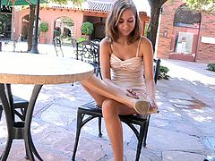 The very pretty Riley does a sexy striptease as she eases off her dress, bra and panties so she can get fully nude while out in public.