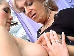 Nasty lesbians are having a rough time masturbating one another