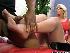 Checkout this huge titted blonde milf Alura Jenson in this hot foot-job video.Milking a big black cock with my pussy is just too easy. There's something to be said for jerking a huge black cock with my feet until it erupts like a ghetto geyser. I got into my naughtiest attire and invited a gigantic block cock to come over and worship my ten little piggies. I had him rub my freshly pedicured feet and toes right before sliding his massive black meat between my arches. I was so tempted to suck his black cock, but that would only mean my feet would be neglected. That's a bad thing. I kept jerking
