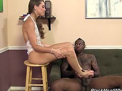 Have a blast watching this babe, with small boobs wearing white lingerie, while she has interracial sex and uses her feet to masturbate this horny dude.