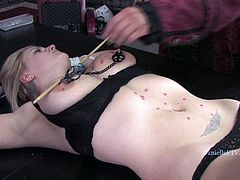 She is tied up and her man puts a burning candle on her tits. It leaks and starts burning her soft skin. She kinda loves some BDSM!