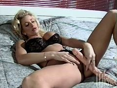Sizzling blonde milf J.R. Carrington is playing dirty games in a bedroom. She fingers her shaved pussy ardently and then fucks her tight holes with dildos.