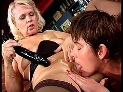 Marketa and Leona play lesbian games in the empty bar. They lick each others pussies and then use big dildo to make it better.