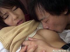 Pretty Japanese girl in school uniform gives a blowjob and gets her teen pussy licked. Later on she undresses and gets fucked doggystyle.