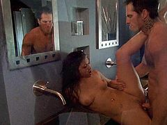This couple made their way into a bathroom, stripped naked and worked up a sweat as they fucked each other's brains out.
