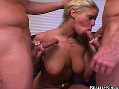She is a double penetration lover and here is how she deals with two huge cocks! She is going to blow them both and both fuck her.