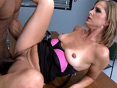 Milf Melissa Rose is a hot policewoman. She's also a dirt cop, since she agrees to let someone go for a good pussy pounding from a guy with a massive black cock.