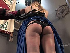 Gorgeous blonde lady in a ball dress gets her boobs fondled. Then a guy ties Danielle up and starts to whip her nice ass.