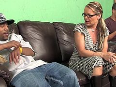 Kelly Leigh sucks big black cock and licks balls expertly. She fondles her pusys to make it as wet as possible because the cock is really big. Then Kelly gets fucked rough and gets her mouth filled with big load of cum.