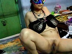 Indian woman with trimmed pussy and giant natural tits poses in the amateur scene.