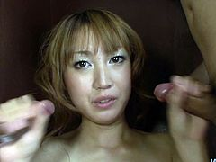Neat Japanese porn babe Yuki Mizuho shows off her cock sucking skills by giving blowjobs to two Asian studs. Girl sucks their hairy dicks in a very sloppy way.
