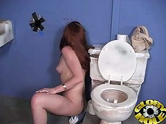This cute redhead babe is in public toilet rubbing her cunt when that dude gives her his stiff black cock through hole to suck it and fuck it.