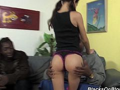 A fuckin' slutty bitch takes on two huge-ass black cocks in this threesome scene and sucks on them then gets stuffed, check it out right here!