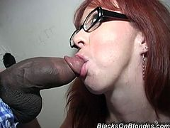 Trinity Post toys her vagina sitting on a chair. She also sucks big black cock and gets fucked rough in close-up scenes. He cums in her mouth and pussy.