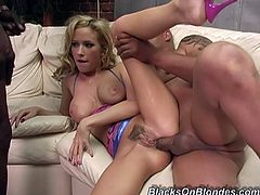 Slutty blonde Hillary Scott is trying her best to please two black studs. She sucks and rubs their shafts and then gets her cunt and ass fucked remarcably well.