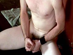 A salacious gay is having fun in front of a camera indoors. He strokes and rubs his boner passionately and stops only when it explodes with jizz.
