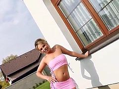 What are you waiting for? Watch this blonde, with born tits wearing a pink miniskirt, while she gets turned on outdoors and later sucks three big dicks!