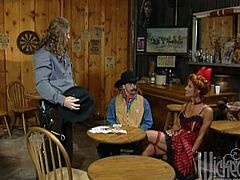 A costumed XXX video with a fair lady in a red dress. She has a wild sex with a stranger in the saloon. This girl gets fucked on a table in close-up scenes.