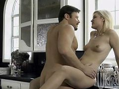 Charming blonde Kimberly Kane is playing dirty games with some dude in the kitchen. She pleases the man with a blowjob and then gets her pussy smashed on the kitchen counter.