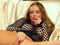 Watch Silvia Saint having an amazing time in this solo scene where this sexy blonde fingers herself while wearing high heels and a sexy dress.