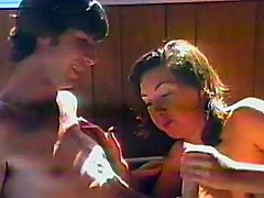 Kinky couple are having fun in a homemade retro scene. The bitch gives a blowjob to the dude and lets him drill her twat from behind.