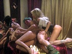 While he fucks one, the other two keep themselves busy fucking and licking each other! Then they all trade for hot fourway action, then he makes them swallow!
