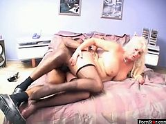 This mature woman looks simply stunning in her sexy black stockings. She knows that she is driving her lover crazy so she lifts her legs up to let him fuck her tight twat. Horny dude pounds her mercilessly in and out pushing her to the edge of powerful orgasm.