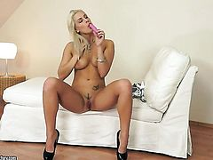 Blonde Blanche Bradburry proves that her body is just perfect as she masturbates completely naked