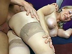 A mature woman in stockings takes hard butt pounding