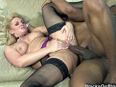 Big-assed blonde milf Flower Tucci wearing stockings is having fun with some dude indoors. She sucks and deepthroats the stud's BBC and then gets her vag smashed and eats the cum which she gets.