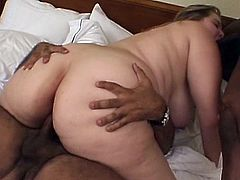 Horny slut receives two strong black snakes to ravish her greedy fat holes
